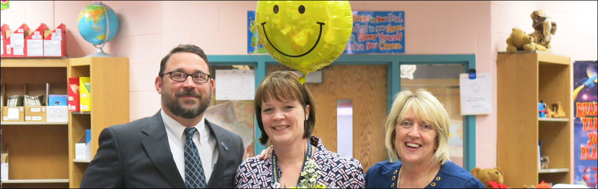 Picture of teacher with Director of Human Resources and Superintendent.