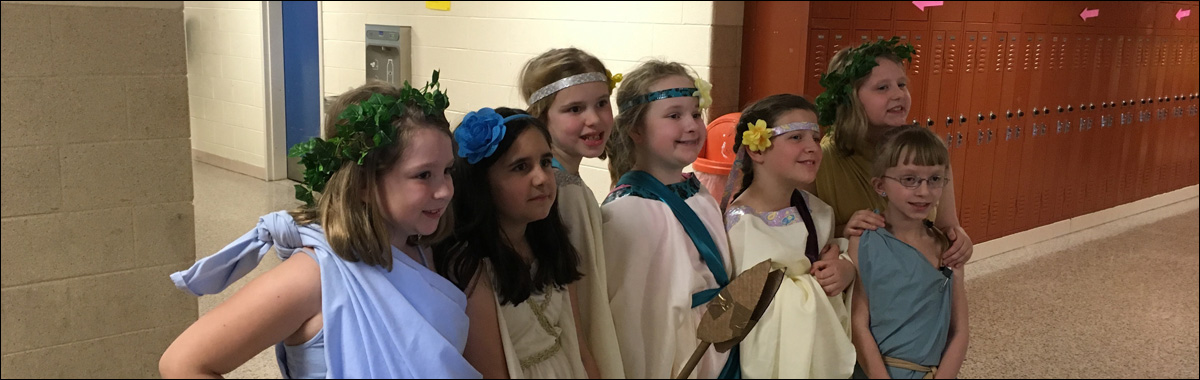Picture of elementary students dressed for a performance of a Greek Mythology play.